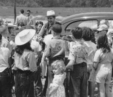 Kids swarm around Cowboy Joe during an outdoor personal appearance. (©2004, Estate of Joseph Pendleton Campbell. All rights reserved.) .