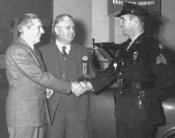 Lt Palmer interviews a local automobile dealer during his weekly radio broadcast on WARL-AM radio. (From the family archives of Helen A. Palmer)