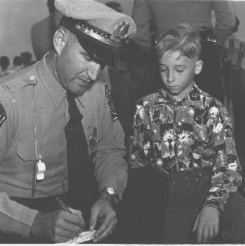 Lt. Palmer signs an autograph for one of his fans (from 1951) (From the family archives of Helen A. Palmer)