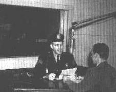 Lt Palmer On the Air for his weekly radio show at WEAM 1390 AM (from the family archives of Helen A. Palmer)